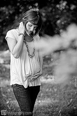Cute maternity photo.  Understated and simple.  Not sure I like the tree in the foreground, but great overall photo.