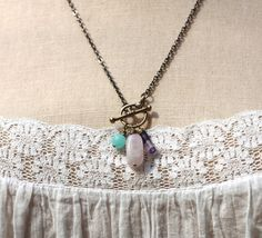 I made a version of this necklace for myself for Mother's Day and after some requests, put it in the shop. It includes pink quartz for opening the heart, an agate for protection, and purple fluorite to help you listen to your intuition. Together, they are an invitation to trust your heart.