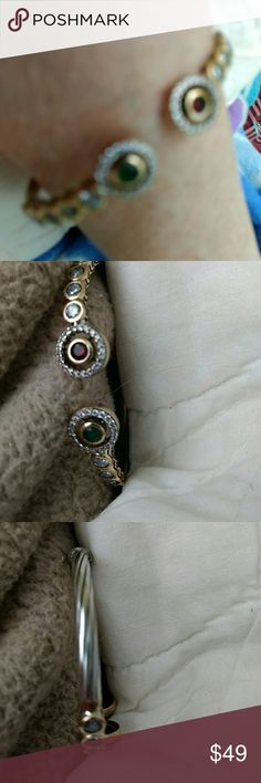 Turkish Sterling Silver Multi Gem Bracelet New Cuff style with a ruby with bronze and white topaz halo.  Emerald with a bronze and white topaz halo.   Twisted Sterling Silver Stamped 925 on the hinge. Will fit large wrists as well. Jewelry Bracelets