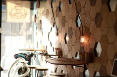 Shipping container coffee place Pan Kralicek in Bratislava, SAfKO. #wood, #hexagon #design #tiles #coffee