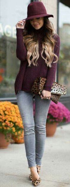Burgundy sweater and hat with gray jeans.