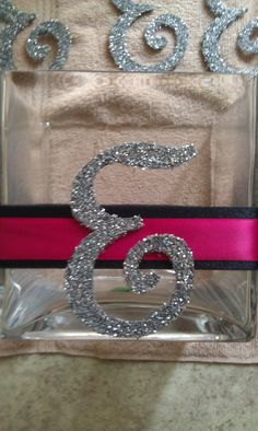 Hand cut letter E out of chipboard and then dipped in glitter