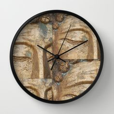"""""""Golden Faces Of Buddha"""" By Linda Prewer. Feel the calm, feel the zen. Available in natural wood, black or white frames, $30.00 - our 10"""" diameter unique Wall Clocks feature a high-impact plexiglass crystal face and a backside hook for easy hanging. Choose black or white hands to match your wall clock frame and art design choice. Clock sits 1.75"""" deep and requires 1 AA battery (not included). #clock #wall #buddha #homedecor #gold #zen"""