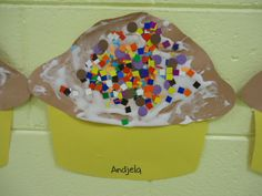 Bakery themed art, we use a mixture of shaving cream and glue on the top of the cup cake and add confetti pieces as sprinkles. Mix 2 parts shaving cream, 1 part glue.