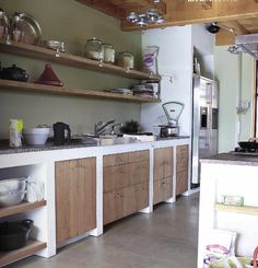 This is pretty much exactly what we would do with the kitchen - floating shelves, concrete and wood counters.