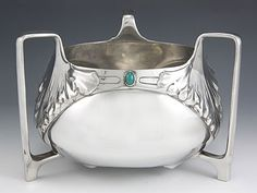 FRIEDRICH ADLER, polished pewter three handled bowl with inset green cabochons, c. 1902, manufactured by ORION, Germany