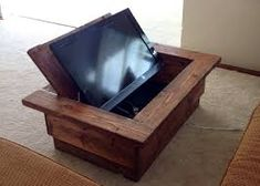 hidden tv coffee table dont have to such large see pop up cabinet Coffee Table Arcade, Arcade Table, Coffe Table, Pop Up Tv Cabinet, Hidden Tv Cabinet, Space Saving Furniture, Diy Furniture, Tv Beamer, Tv Escondida