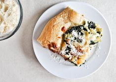 In the process of making this....RIGHT NOW...Cheesy Spinach and Artichoke Pizza I howsweeteats.com