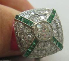 Superb art deco halo target diamonds and emeralds platinum ring