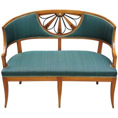 Small finely detailed Viennese Biedermeier barrel back settee in cherry wood on pine. Seat-back with radial pierced fan motif, partly ebonized. Original brass rosette. Padded seat and seat-back covered with horsehair in Russian green.