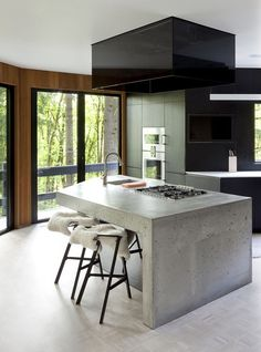 concrete & black in the kitchen