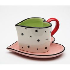 Charming and romantic, this heart-themed cup and saucer set will have your beverages warm all over in no time. Includes cup and saucerCup: W x H x DSaucer: W x DCup holds 5 oz. Cup And Saucer Set, Tea Cup Saucer, Tea Cafe, Custom Printed Mugs, Ceramic Cups, Hand Painted Ceramics, Pink And Green, Heart Shapes, Tea Pots