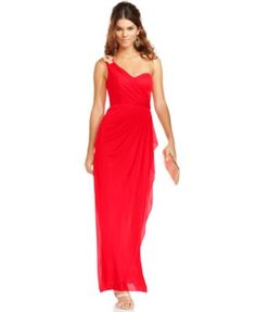 The gorgeous drape of this Xscape evening gown elicits Grecian glamour. The rhinestone brooch at one shoulder is a dazzling finishing flourish!