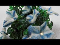 Eine Wanddekoration in Traubenform, bestehend aus: künstlichen Efeu, gefilzten Clematisblüten und einer LED Lichterkette, wird dir in diesen Blog- Beitrag vorgestellt. Für das filzen der Clematis b…