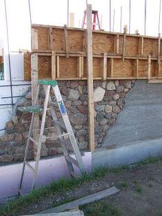 Slipform stone masonry wall.