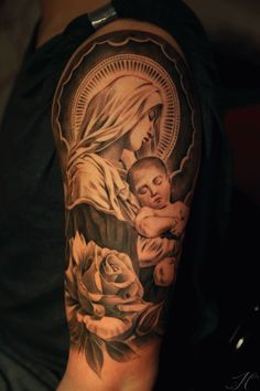 Virgin Mary with roses arm tattoo by Noah