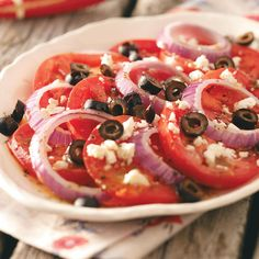 Easy Garden Tomatoes Recipe -Simple as it is, this tomato recipe is one my favorite dishes, and my family loves it. I made three batches the first time, and a few stray olive slices were the only thing left on the platter. —Heather Ahrens, Columbus, Ohio