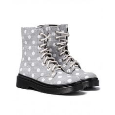 Ankle boots with laces and side zip closure. Polka dot fabric uppers, microfiber lining and matte PVC bottom.