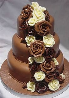 Chocolate cake with chocolate roses milk and white
