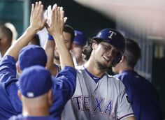 Yu Darvish celebrates in the dugout after hitting a solo home run in the fifth inning Wednesday, Aug. 24, 2016, in Cincinnati. (AP Photo/John Minchillo)
