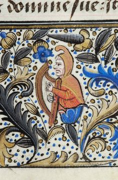 Half figure of man emerging from flower, wearing pointed hood and playing harp | Book of Hours | Belgium, Bruges | ca. 1470 | The Morgan Library & Museum