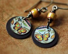 Hey, I found this really awesome Etsy listing at https://www.etsy.com/listing/279860064/vintage-tin-yellow-butterfly-earrings