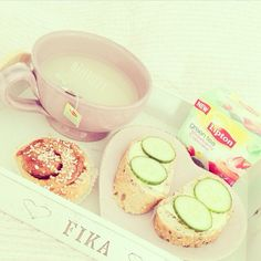 Tea, a cinnamon roll and toast with cheese and cucumber! Xx :))