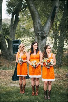 Orange bridesmaid dresses with cowgirl boots!