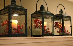 Candles in Lanterns with berries. - Love the lanterns.  - The Yellow Cape Cod: Christmas Home Tour 2010