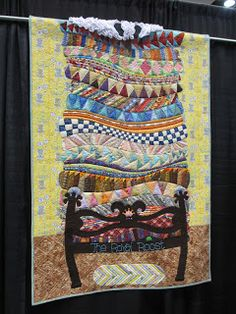 Love this!  It would be fun to do with fabric from quilts you've madr