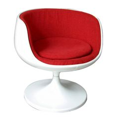 Eero Aarnio Cognac Chair:1967  Finland    Lacquered fibreglass, fabric.