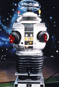 "Lost in Space was first imagined as a modern version of ""Swiss Family Robinson"".  One of the coolest aspects of the show was their robot.  In the beginning the Robot was merely a tool, but eventually it developed a personality all its own and became a part of the family.  The Lost in Space robot was cool."