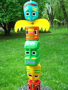 Make this fun Totem Pole from discarded plastic milk cartons, coffee containers and some paint. Cool Totem Pole Craft Projects For Kids, http://hative.com/cool-totem-pole-craft-projects-for-kids/,