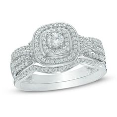 1/2 CT. T.W. Diamond Cushion Frame Twist Shank Bridal Set In 10K White Gold