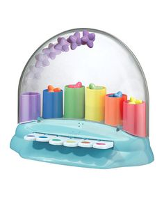 This enchanting toy encourages little learners to press the keys on the piano to produce sweet sounds and send the shooting stars popping out of the pipes! With additional sound effects and a removable top, this charming toy keeps kids busy while developing their fine motor skills, sensory development and the concept of self-expression.