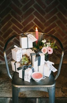 """Beautifully wrapped tea cup candle favors. Calligraphy """"thank you"""" tags by Meme Davis Calligraphy."""