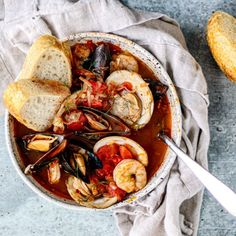 This cozy and smokey cioppino is brimming with tomatoes, mussels, clams, shrimp, and smoked kipper snacks. Italian Seafood Stew, Mussels, Clams, Ratatouille, Soups And Stews, Eating Healthy, Paella, Cooking Tips, Tomatoes