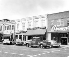Florida Memory - Looking at stores on the west side of Monroe Street between College and Park - Tallahassee, Florida