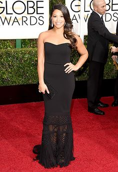 Gina Rodriguez - 2015 Golden Globes  - The Jane the Virgin star modeled a strapless dress with an embellished, semi-sheer skirt by Badgley Mischka, dangling earrings, and Jimmy Choo heels #GoldenGlobes #BagleyMischka