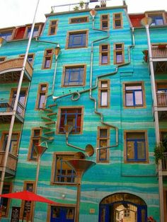 This building is located in Dresden, Germany. It's called Neustadt Kunsthofpassage. And when it rains it starts to play music. Wish I saw this when I was in Dresden! >:( it was raining that day too! Places To Go, The Places Youll Go, Dresden Germany, Water Walls, When It Rains, Nautilus, To Infinity And Beyond, The Good Place, Perfect Place