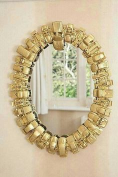 Cute idea for gift or kids room. My daughter (loves) plays with cars, this would be ideal to do down the road. Spray paint gold & hot gule on round mirror frame.   G;)