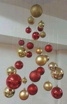 Easy and Affordable Homemade Christmas Decorations – Invisible Christmas Trees- Learn how to make these hanging Christmas trees for easy and affordable holiday decor These are also super fun Christmas crafts kids will love to make Office Christmas Decorations, Hanging Christmas Tree, Homemade Christmas Decorations, Christmas Centerpieces, Christmas Crafts For Kids, Christmas Tree Toppers, Simple Christmas, Christmas Wreaths, Holiday Decor