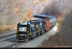 RailPictures.Net Photo: NS 6322 Norfolk Southern EMD SD40E at Cassandra, Pennsylvania by Jason Boring. With a ton of coal passing over, another heavy crude oil train follows up the hill behind them as helpers push the train up the grade.