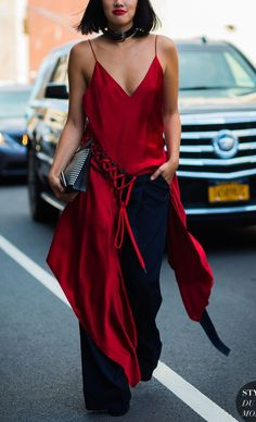 This red silk top with lace-up detail makes for the perfect street style look for summer. Shop our favorite summer tops!