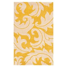 Hand-tufted New Zealand wool rug with a scrolling leaf motif.  Product: RugConstruction Material: Wool