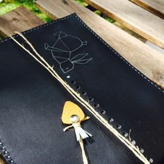 black leather iPad case with origami rabbit and her carrot