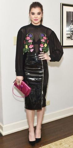 Hailee Steinfeld turned up the smolder for the Christopher Kane x MyTheresa dinner in head-to-toe Christopher Kane, naturally, which consisted of a sheer floral-embroidered top tucked into a patent leather zip-front pencil skirt, complete with a metallic pink purse and black pumps.