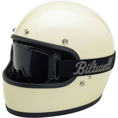Biltwell Gringo DOT Helmet - Gloss Vintage White  • Injection-molded ABS outer shell with hand-painted finish • Expanded polystyrene inner shell • Hand-sewn brushed Lycra liner w/ contrasting diamond-stitched quilted open-cell foam padding • Meets DOT safety standards • Internal BioFoam chin pad with hand-sewn contrast stitching • Rugged plated steel D-ring neck strap with adjustment strap end retainer • Rubber edging on shell and eye port  $159.95