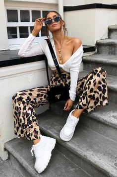 great outfit idea : white top   bag   sneakers   leopard pants White Jeans