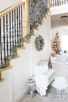Lovely white-on-white colour scheme for Christmas decor - see the full home tour at Thrifty and Chic!